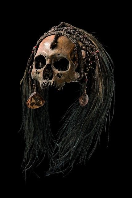 Asmat people: skull of headhunted enemy ( and not of ancestor); the lower jaw is…