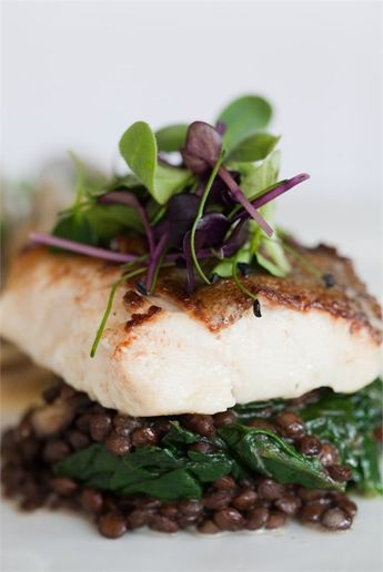 Pan fried cod with wilted spinach on puy lentils