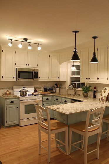 Love the difference in color from top to bottom cabinets. Fresh new kitchen- great lighting and countertops!