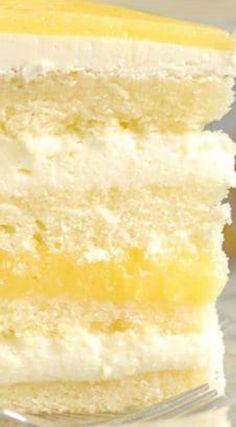 Luscious Lemon Mousse Cake ~ The perfect layer cake... Lemon cake with Limoncello syrup, zesty lemon curd and creamy lemon mousse. (Limoncello liquor is optional.)
