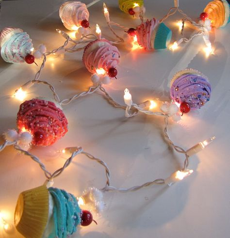 Fake cupcakes + string lights, possibly THE perfect birthday decor <3