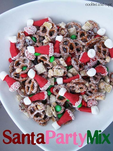 Santa Hat Party Mix, a simple and delicious Snack Mix... with Bugles dipped to look like Santa Hats!! Click through for FULL tutorial!!