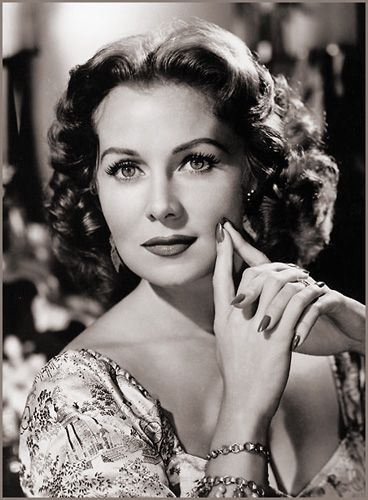 Rhonda Fleming --   I think it's between Rhonda Fleming and Virginia Mayo .. for my first celebrity crush!!  In my opinion Ms. Fleming should be on everyone's Top list for most beautiful actresses ever.