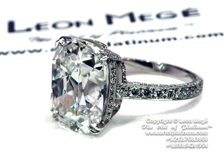 Antique cushion cut diamond engagement ring by Leon Mege. Absolutely head over heels for the side detailing, setting, and band! I would just want a 2-3 karat diamond though. Must be cushion cut!