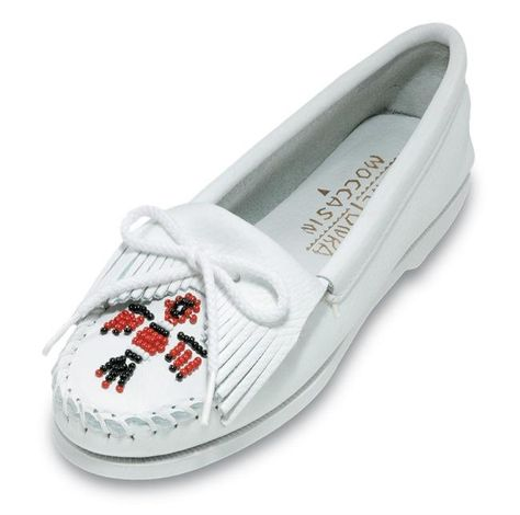 Minnetonka Moccasin's exclusive Thunderbird bead design is recognized throughout the world. Nothing says authentic, relaxed or casual better. Stitched-on boat sole with padded cushion sole. Available in Natural, Navy, or White. Sizes 4-11 (1/2 sizes included, no 10.5). THIS PRODUCT CANNOT BE SHIPPED OUTSIDE THE UNITED STATES Made in Dominican Republic of American materials. Smooth Leather, White Leather, Suede Leather, Old Friend Slippers, Nostalgia, Retro, Leather Moccasins, Leather Sandals, Minnetonka Shoes