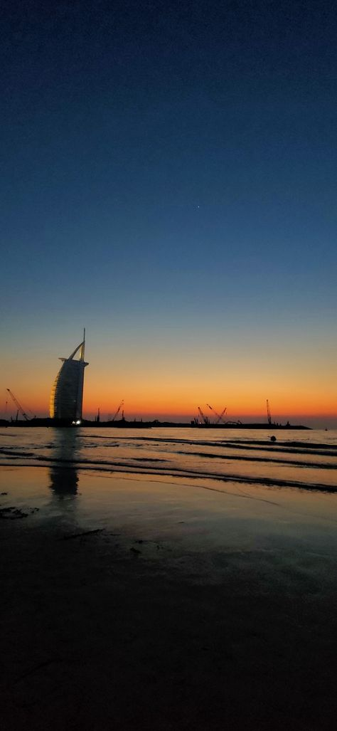 Sunset, Beach and the magnificent Burj Al Arab! -------------------------   #travel #dubai #uae #reflections #unitedarabemirates #beachvieq #palmbeachjumeirah #burjalarab #beach #dubaigallery #travelislove #amateurphotographer #sky #photography #sunset #colours #goldenhour #travelphotography #youngartist