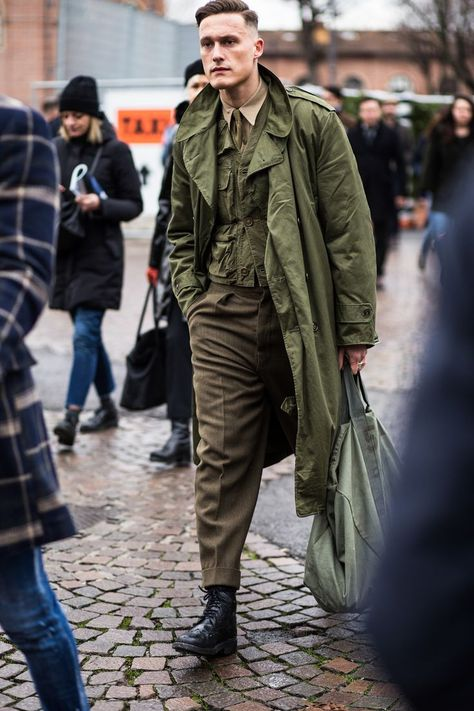 Men's street stye outfit from Fashion Week - love this military trench coat, and you? #streetstyle #outerwear #trenchcoat #mensfashion