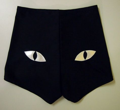 Super comfy black roller derby shorts with metallic silver cat eyes on the butt.