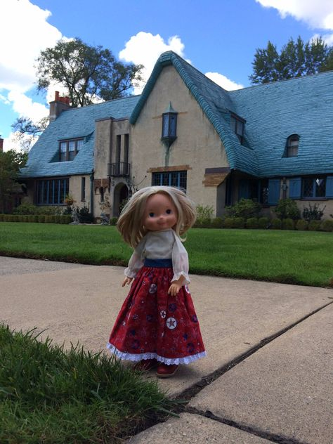 My Friend Mandy wearing homemade skirt and vintage shirt in front of Storybook cottage in Michigan.