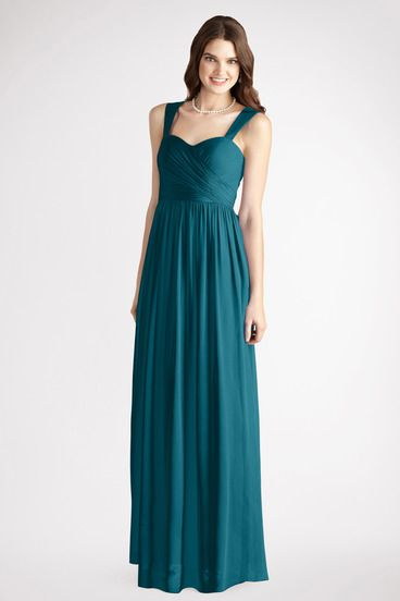 A thin belt accents this strapless long chiffon gown with a crisscross  ruched bodice and flowy skirt.  97755e84c