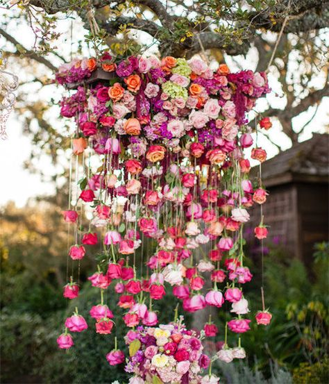 Hang individual roses upside down or choose to hang entire bunches for a real statement installation. The inverted wall of roses will look beautiful and provide a unique backdrop for wedding photos.