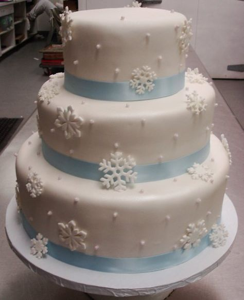 Snowflake Wedding Cake, really like this idea but will need red ribbon and initial topper