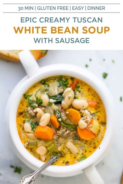 This Creamy Tuscan White Bean Soup with Sausage comes together in 30 minutes. It's the perfect quick and easy dinner when you're looking for something hearty and healthy - filled with spinach, carrots, white beans and sausage for one comforting bite! #souprecipes #tuscanrecipes #sausage #glutenfree #dairyfree #sausage #spinach #beansoup