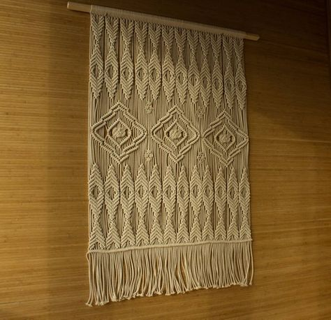 This macrame tapestry is pure beauty. This extra large macrame wall hanging is love from the first sight. I really like the texture of the macrame rope and rhythm of the knots. Its retro-inspired geometric pattern is about balance and beauty. I created this modern macrame