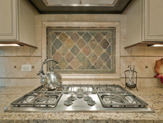 Kitchen Backsplash Focal Point simple tiles with border then colorful simple tiles above cooktop