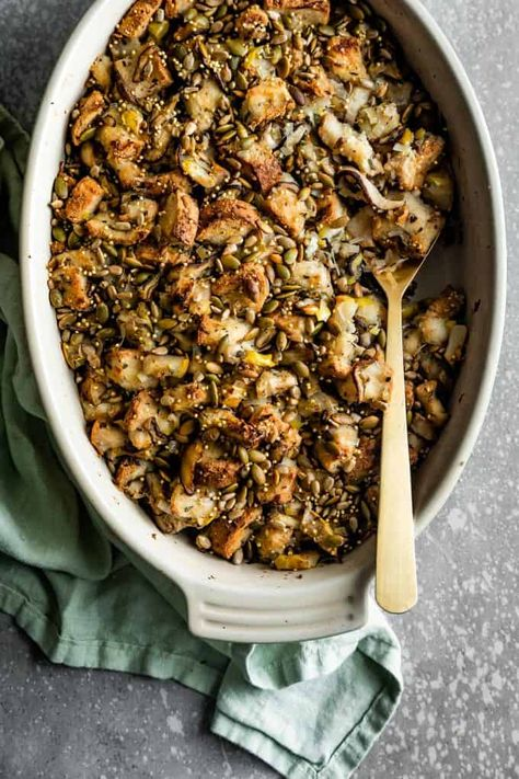 A vegan gluten-free stuffing so flavorful, no one will believe it's vegan! Packed with mushrooms, pears, leeks, and topped with crunchy seeds, this hearty and filling stuffing is the perfect addition to your holiday table! #HalfYourPlate #Stuffing #VeganStuffing #VegetarianStuffing #StuffingRecipe #mushroom #MushroomRecipe #Pear #PearRecipe #PearStuffing #MushroomStuffing #MushroomPear #Holiday #HolidayStuffing #HolidaySides