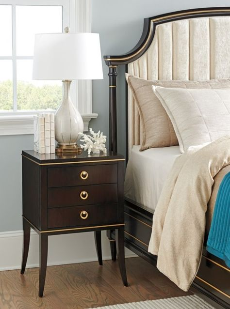 For refined, timeless decor with glitz and glam to spare, choose unforgettable pieces like this nightstand. It echoes back to the days of Hollywood starlets and classic crooners. The small-scale nightstand is finished in a rich Espresso color with delicate touches of gold striping. The drawer hardware sets a remarkable statement with satin gold finish and inlaid mother of pearl.