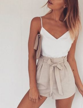 simple spring look with white tank top with cream shorts  and cream bag