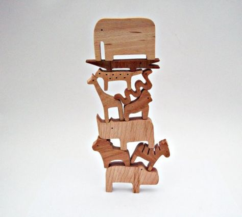 Invite them to try a balancing act - Awesome Wooden Toys For Kids - Photos
