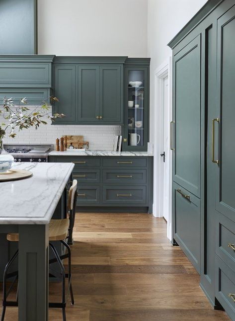 We've told you all about our love for green kitchens. Blue kitchens are high on our lists, too. If you're torn between these two hues, guess what? You can have the best of both worlds with a teal kitchen. #hunkerhome #kitchen #teal #tealkitchen #kitchenideas
