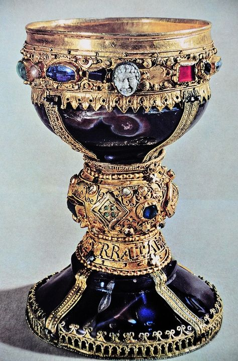 Caliz de Doña Urraca (11th c. CE) Colegiata de San Isidoro de León (Spain) -- It is made of two pieces of dark blueish onyx that is said to be of Roman origin, and around them the artisans of León made a great work with gold, filigree, enamel, pearls and gems, blending Spanish and Western European taste with Byzantine goldsmith's art models