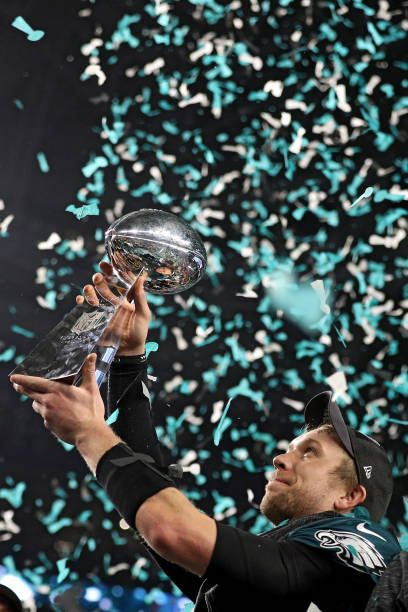 Quarterback Nick Foles 9 Of The Philadelphia Eagles Raises The Vince Lombardi Trophy After Defeating The Philadelphia Eagles Nfl Football Pictures Eagles Win