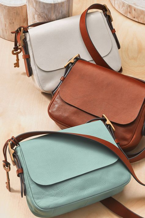 """Meet spring's newest """"it"""" bag. Harper is a sleek shoulder companion with clean lines, adjustable straps, and interior-only pockets. It's your new go-to everyday crossbody."""