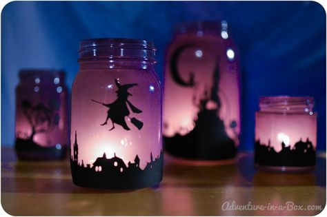 Download the design of the silhouette town to make the enchanting Halloween lanterns, described here.