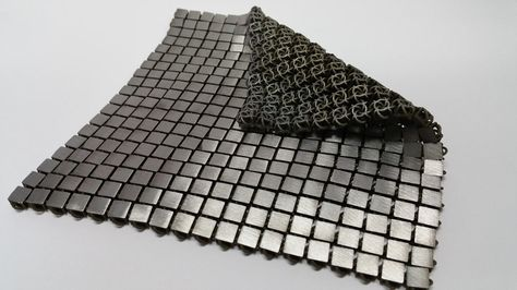 The bottom and top sides of the space fabric are designed to have different properties