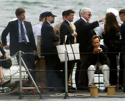 Family mourns John and Carolyn aboard the USS Briscoe the day their ashes were scattered at sea.  Anthony Radziwill seated with chin on hands.  Sen. Edward Kennedy behind him.  William Kennedy Smith to the far left.