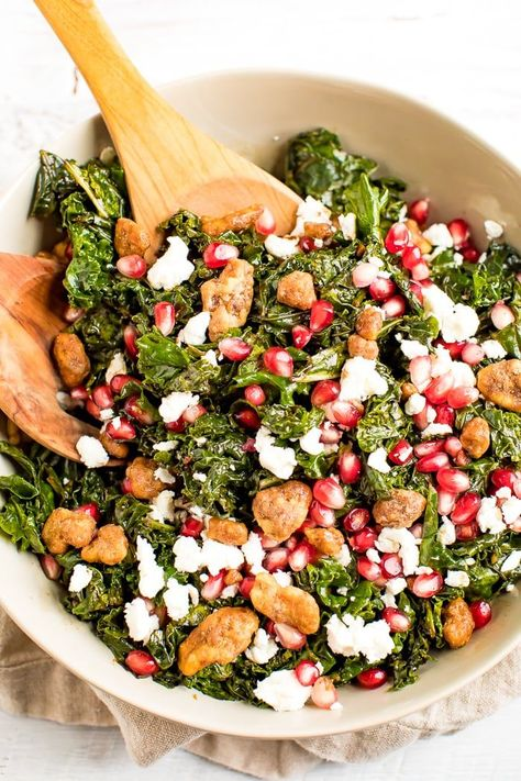 This kale pomegranate salad is super easy to whip up and makes for a festive and healthy red and green centerpiece. Perfect for serving at Christmas dinner or brunch.#christmassalad #holidaysalad #kalesalad