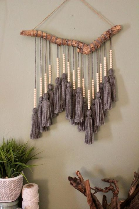 Easy driftwood Macrame hanging Driftwood foundation was found washed up on the coast of Florida near Fort Lauderdale beach. Yarn was individually measured, cut, and tied to create one single tassel. Small wooden beads were then Mur Diy, Yarn Wall Art, Wall Art Boho, Diy Wall Art, Diy And Crafts, Arts And Crafts, Diy Crafts With Yarn, Rope Crafts, Feather Crafts