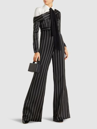 Discover the One-Shouldered Striped Satin Jumpsuit by SAFiYAA at The Modist. Shop the range today and discover