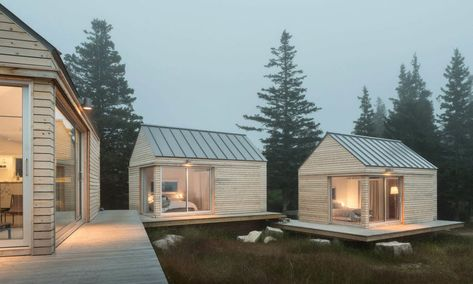 Maine-based architects' Little House on the Ferry is comprised of three cabins connected by a series of terraced decks, all constructed out of low-impact CLT panels and various energy-efficient features.