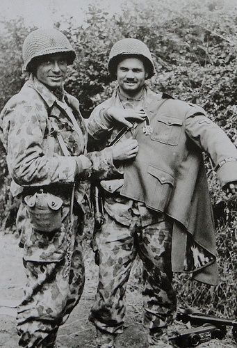 Two American soldiers (2nd Armor?) showing off a captured German