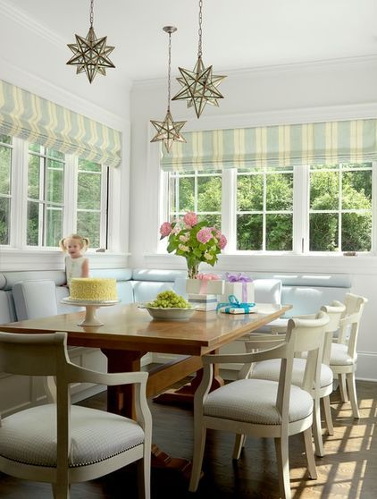 Choose special lighting. Moravian star light fixtures hung at varying lengths add a touch of whimsy overhead. Install a dimmer for your nook lighting so you can turn off the main kitchen recessed lights and control the mood for meals.