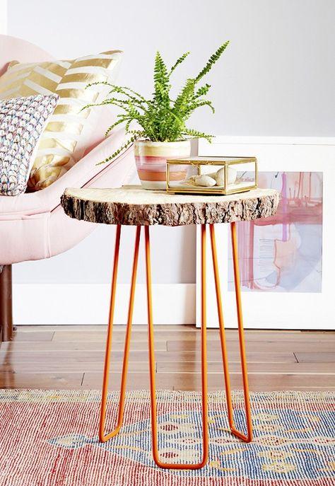 DIY log slice table with orange hairpin legs.