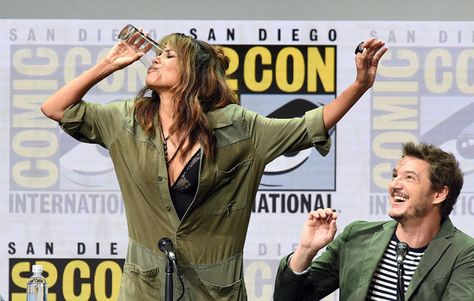 Actor Halle Berry (L) takes a drink onstage while actor Pedro Pascal looks on at the 20th Century FOX panel during Comic-Con International 2017 at San Diego Convention Center on July 20, 2017 in San Diego, California.