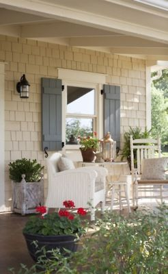 LOVELY front porch! I love the trim around the window too (matches perfectly with what we're going to do with the windows/doorways on the inside.