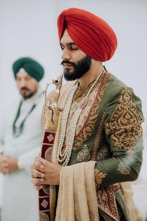 Punjabi groom prays while holding kirpan. Photograph by Catch Motion Photography, VA #wedding #groom #sikhwedding #kirpan #turban #indianwedding #weddingphotography #covidwedding #backyardwedding