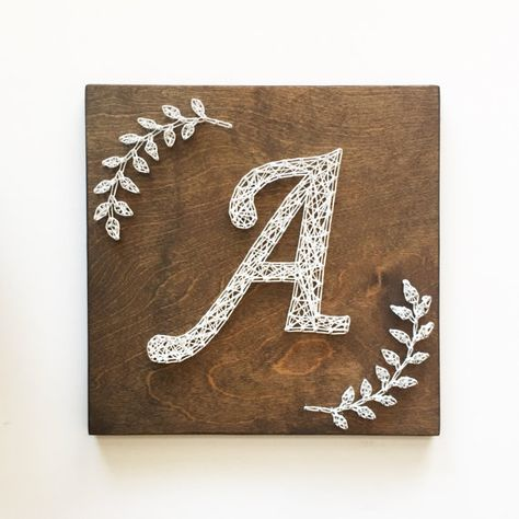 Monogram Initial with Laurel Branches Can be created with other fonts - please inquire. Can be created in larger sizes - please inquire for pricing info. Please indicate choices for stain color and string color(s). Item will come with hole drilled in back for hanging. Items