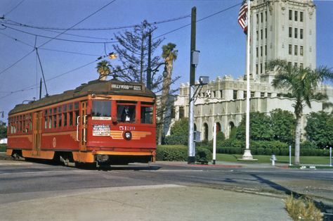 A Red Car on the Hollywood Line rolls past Beverly Hills' City Hall in 1950.  Until the early 1970s it was commonplace to see a train travel down Santa Monica Boulevard along the business triangle through the city.  Today those tracks have been replaced by parking structures but you can still see the Pacific Electric right-of-way fenced off on parts of what used to be known as Railroad Avenue. #beverlyhillsheritage #railroad #redcar #beverlyhillshistory