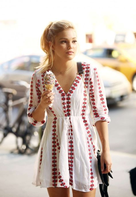 Olivia Holt, eating an icecream cone with sprinkles.