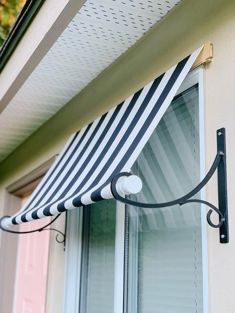 Does your garden shed need some TLC? Today I'm sharing how I gave my shed a whole new look with a door refresh and DIY awning! Outdoor Window Awnings, Patio Awnings, Pergola, Window Coverings, Window Treatments, Awning Over Door, Diy Awning, Diy Exterior Window Awning, Shed Awning Ideas