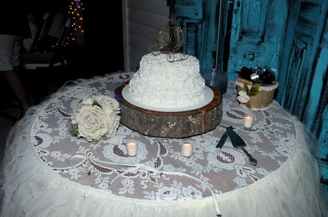 #tootskiwedding #reception #southerncharm #shabbychic #rustic #outdoorreception #bistrolights #birdcages #candles #babiesbreath #lace #burlap #masonjars #woodround #woodencakestand #tulle #cake #bouquet #homemadebouquet  #weddingideas