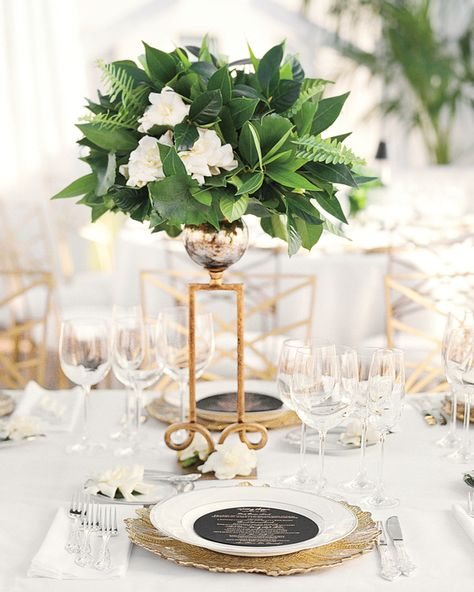 These tall, scroll-like gold vessels held gardenias and ferns from Mindy Rice, and gave the white tables a glamourous