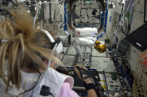 Geared up for tele-operations with Robonaut, where my movements become his. KN from space.