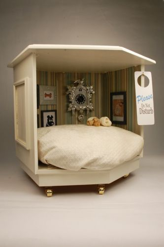 This is totally pet-posh. Made from an old living room end table.