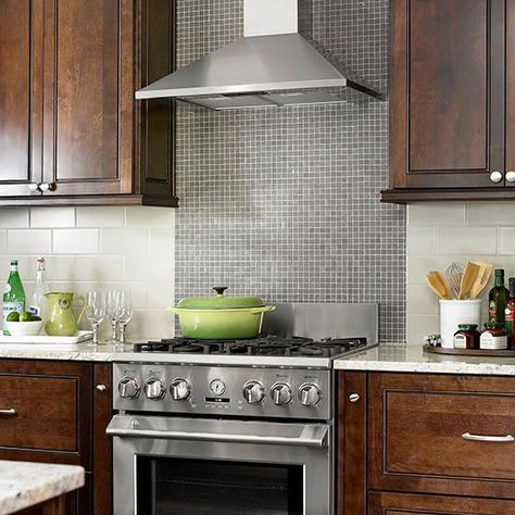 Contrasting Tile BacksplashTiny glass mosaic tiles form the range backsplash in this chic, old-meets-new kitchen. Larger light gray subway tiles run horizontally above the countertop and allow the range backsplash to be the kitchen's standout surface.