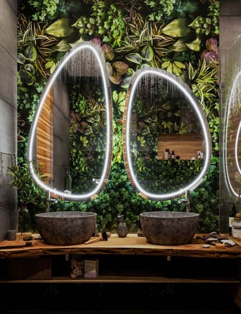 """I really like the irregular-shaped mirrors usead here. (not excited about the """"living wall""""- a bit over-the-top)"""